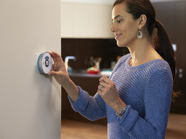 Lyric women at thermostat