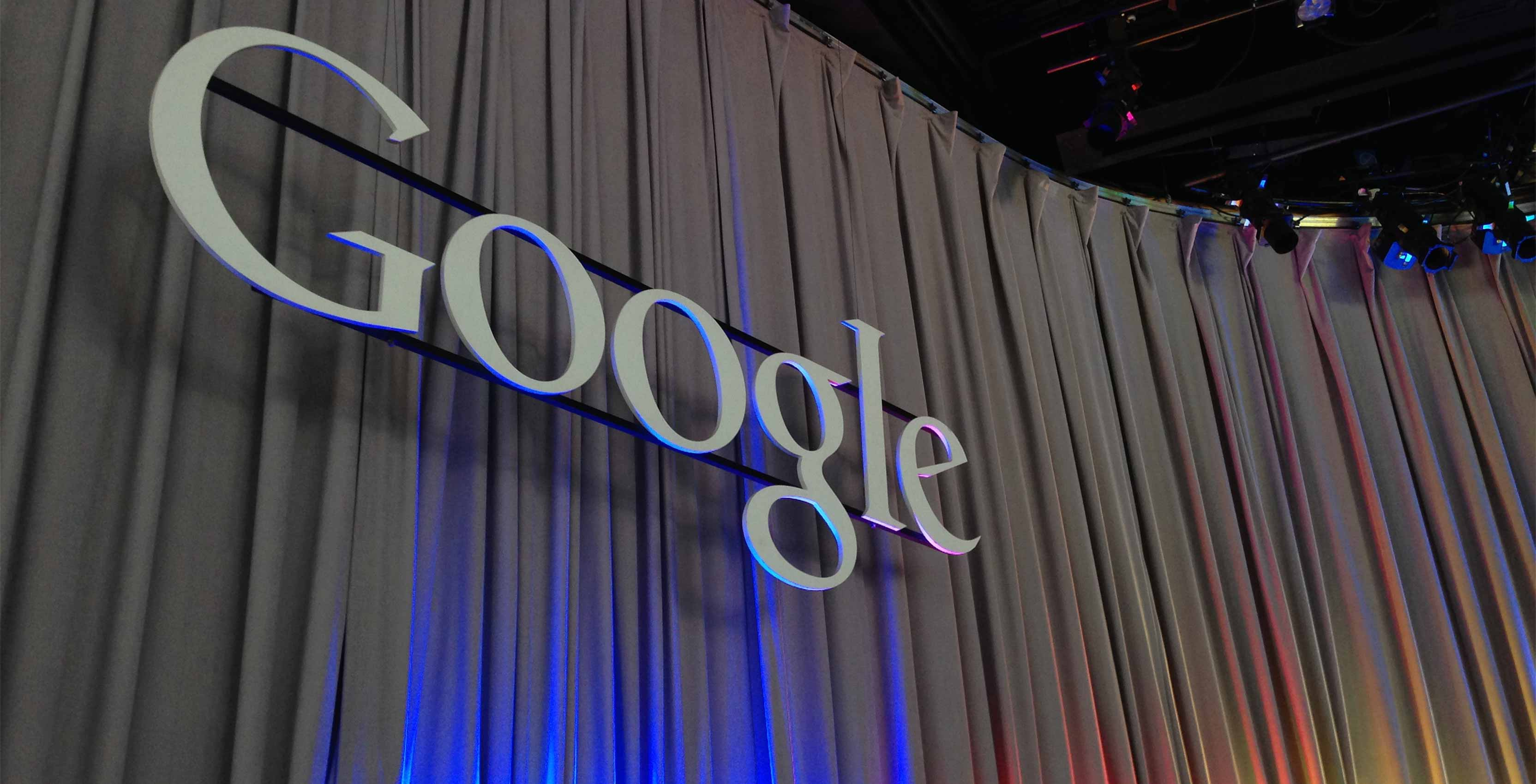 Google's logo at a press conference about google ai