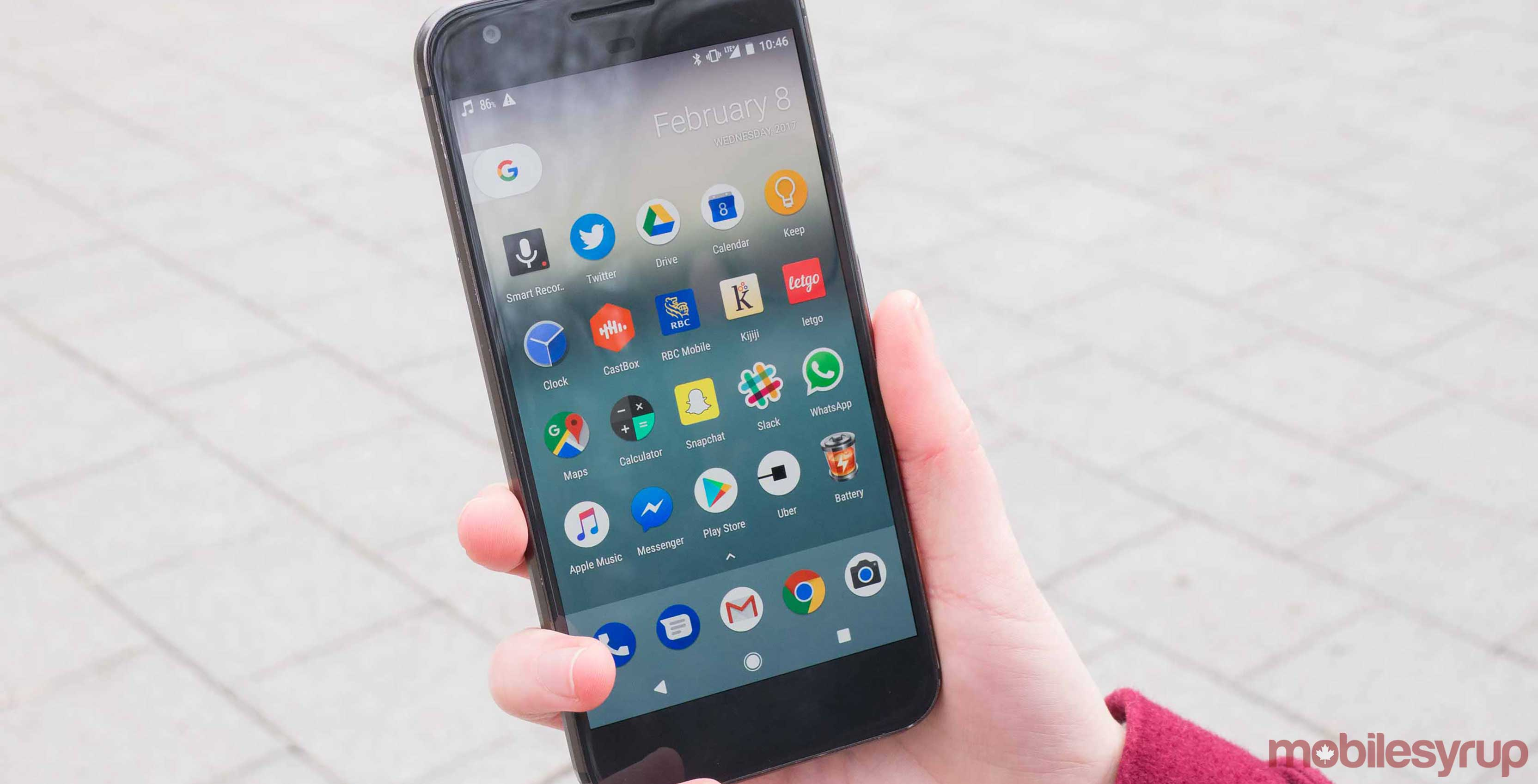 Google Pixel smartphone held in a hand
