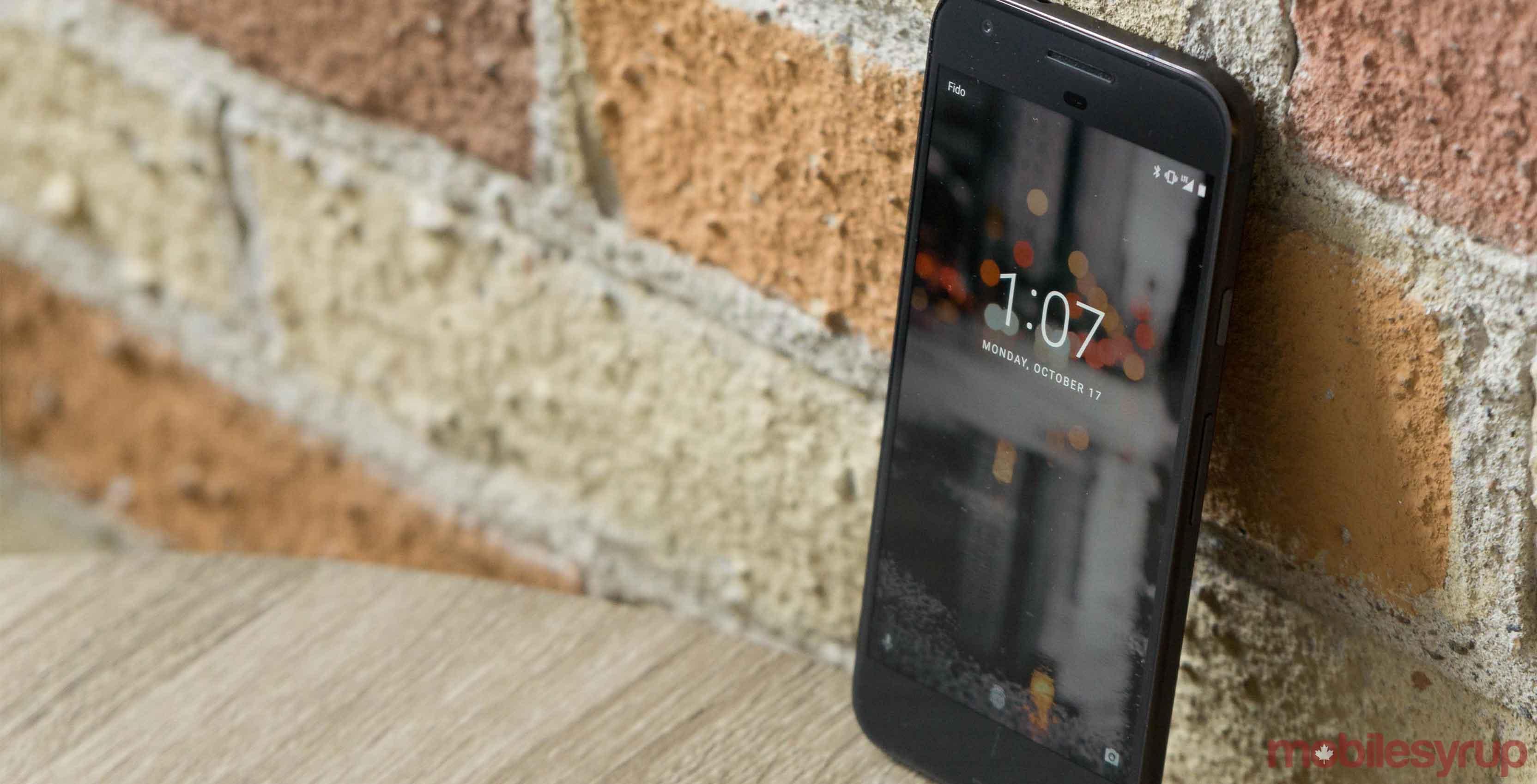 Google Pixel smartphone against wall