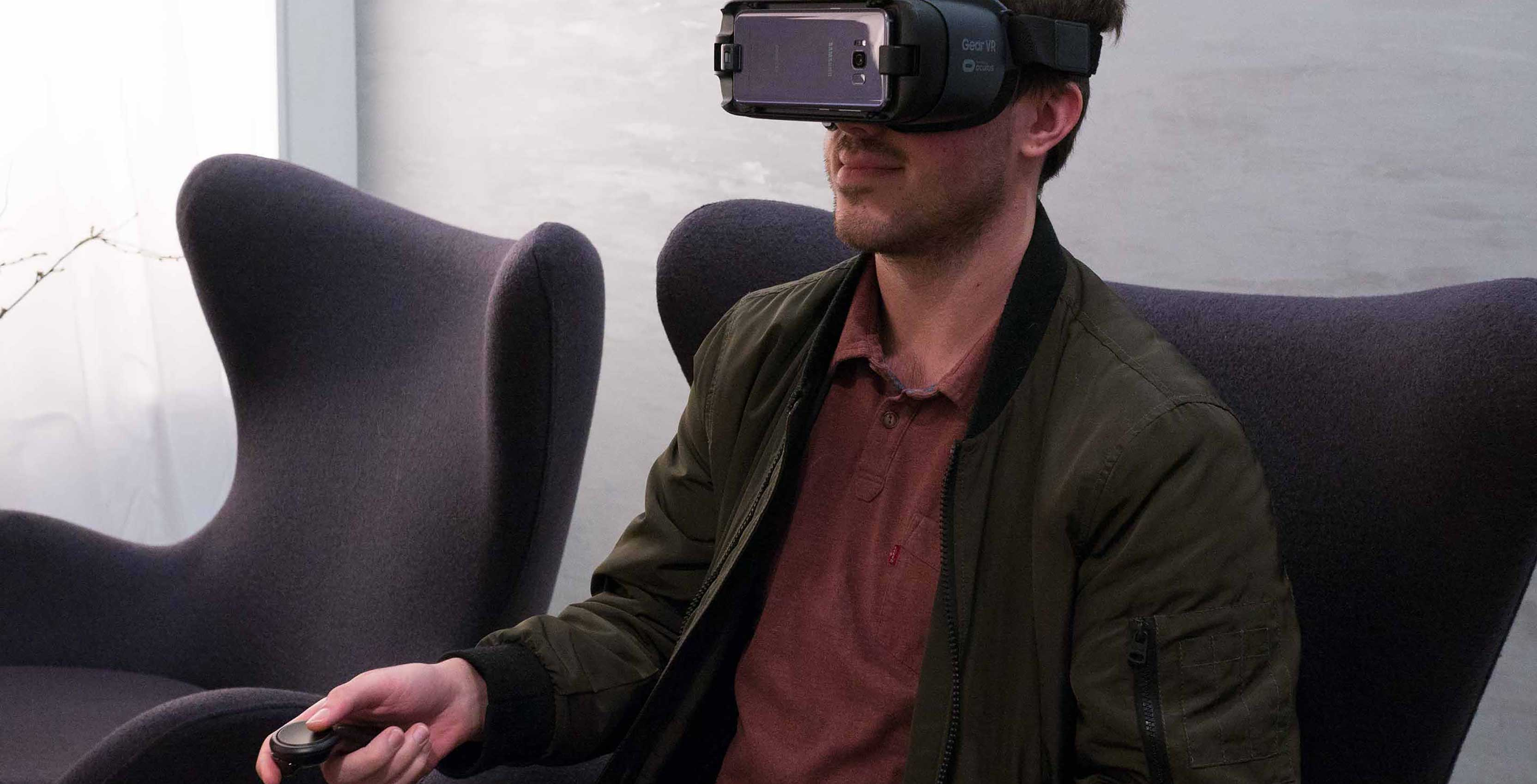Man with VR headset watching content