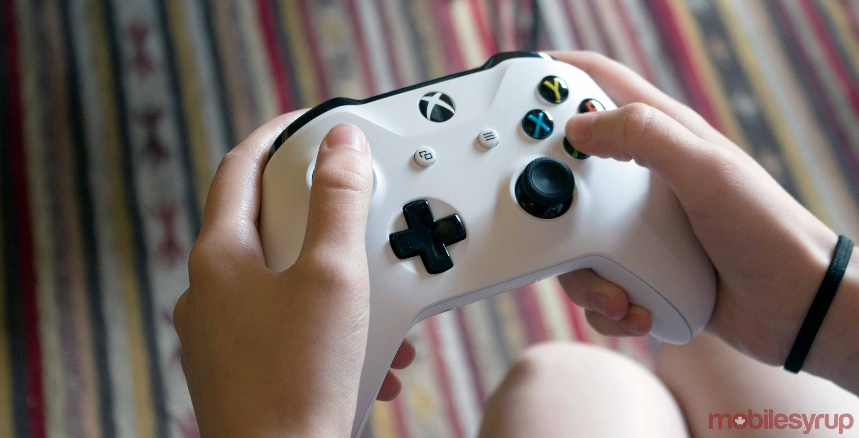 Xbox One white controller in hands