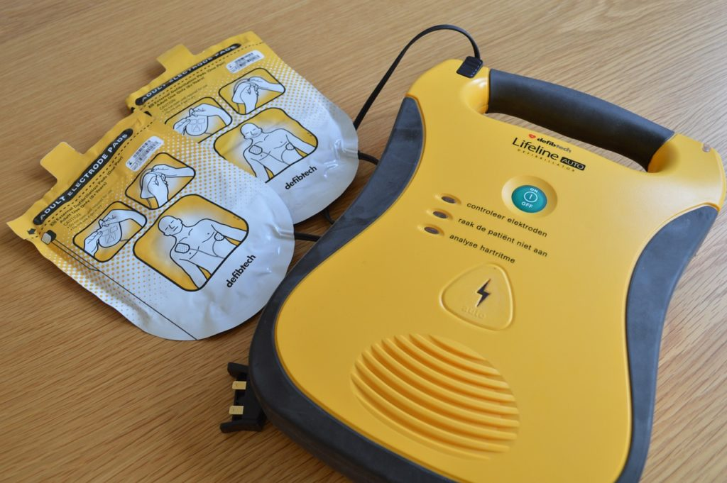 Yellow AED on table