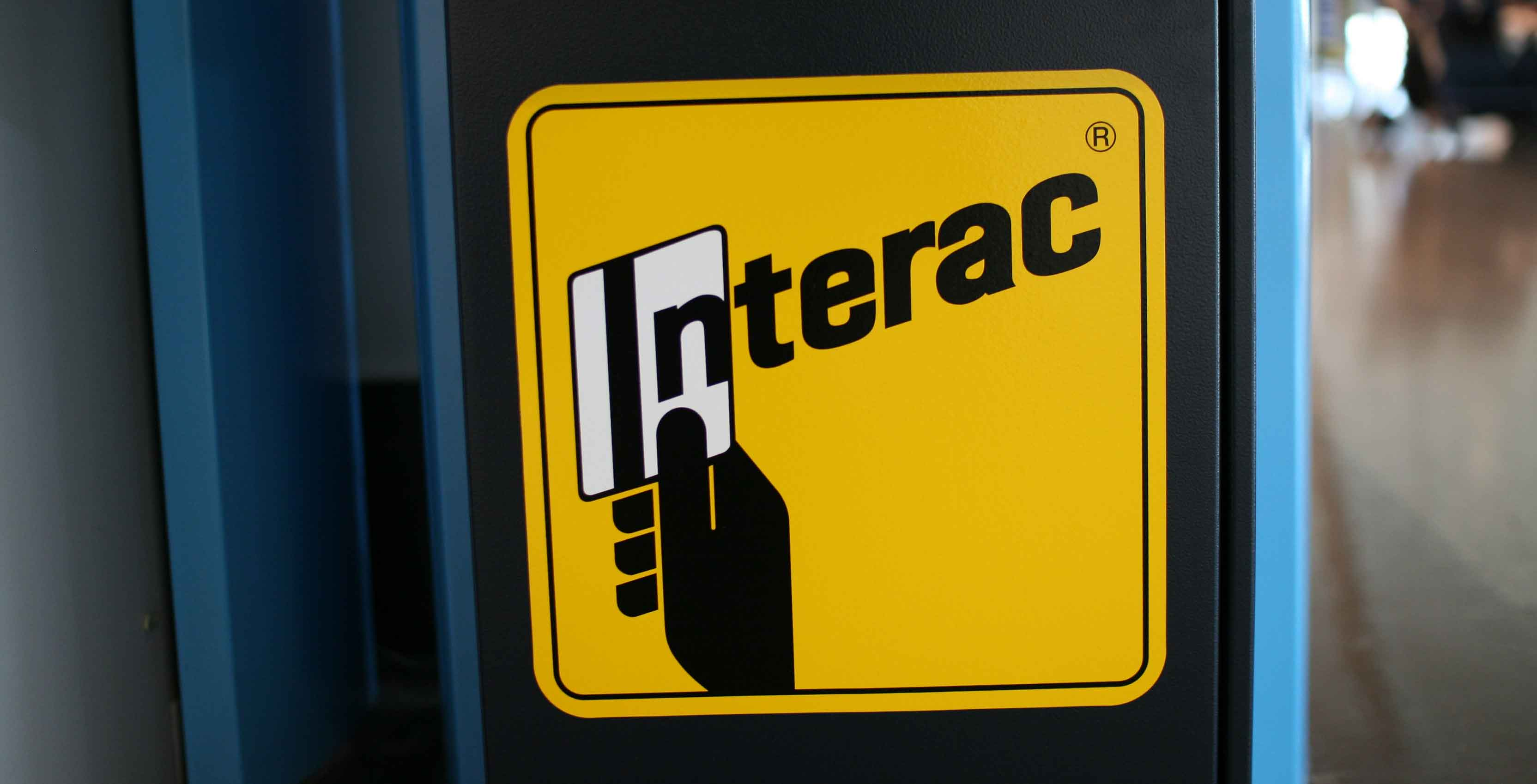 interac sticker on the wall