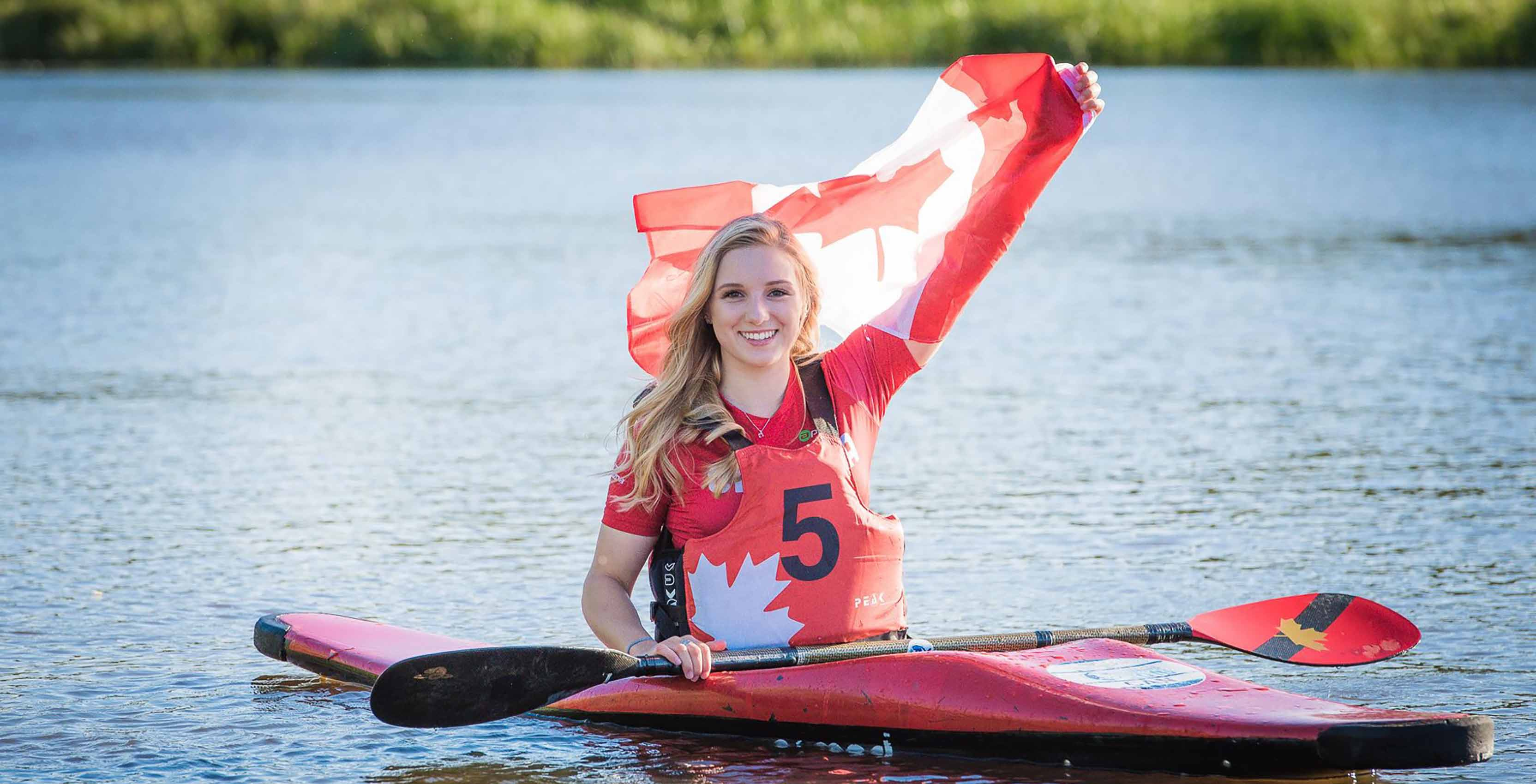 woman with Canadian flag in kayak