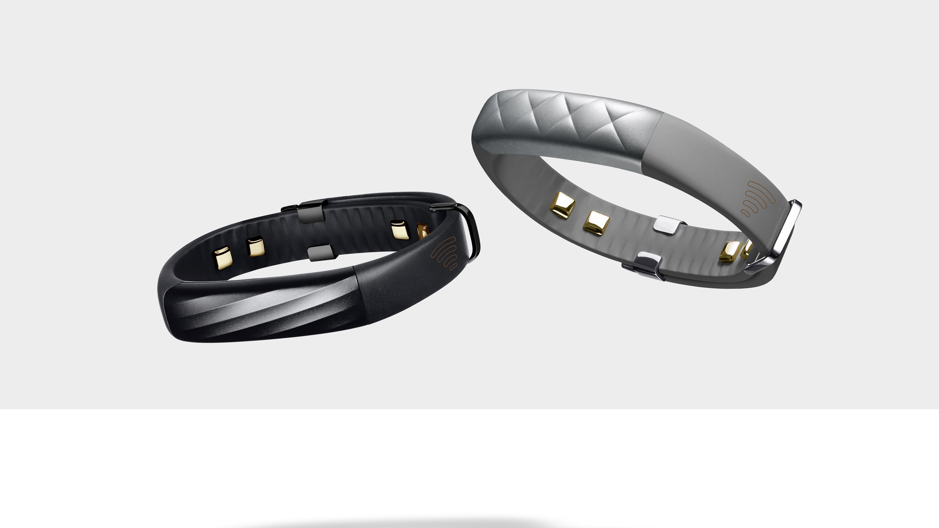 Jawbone black and silver fitness trackers