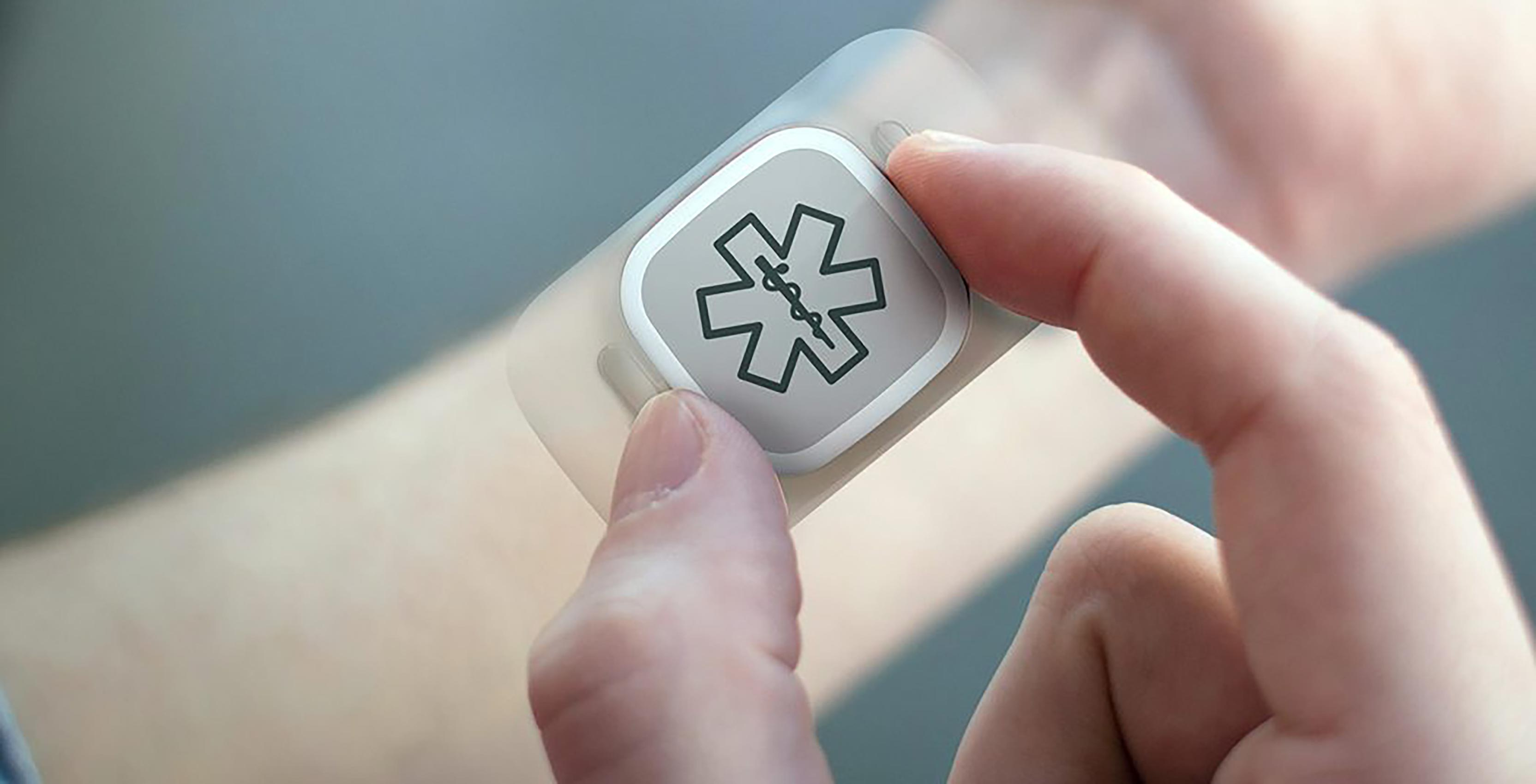 Wearable in hand with medical symbol