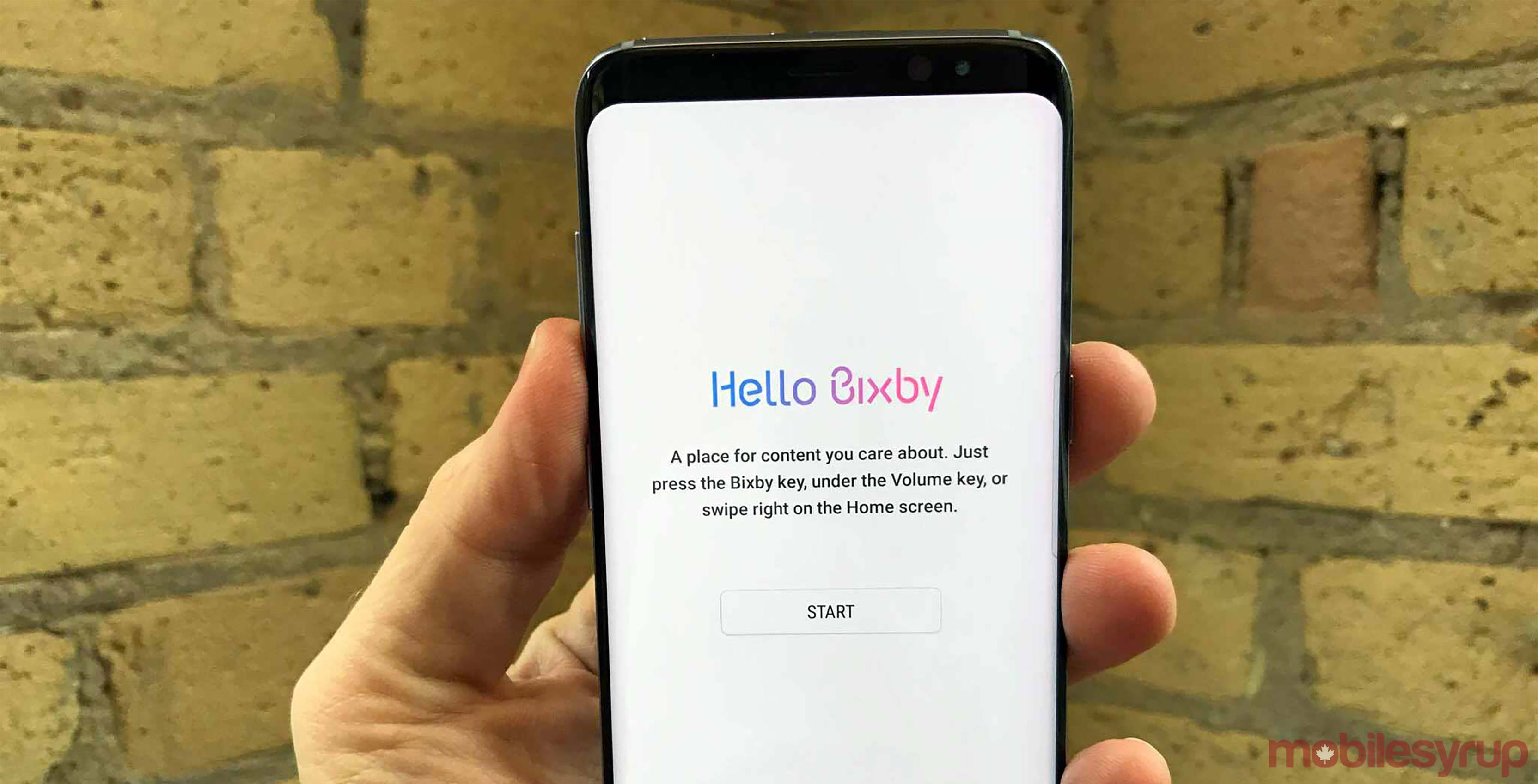 Bixby on phone in hand