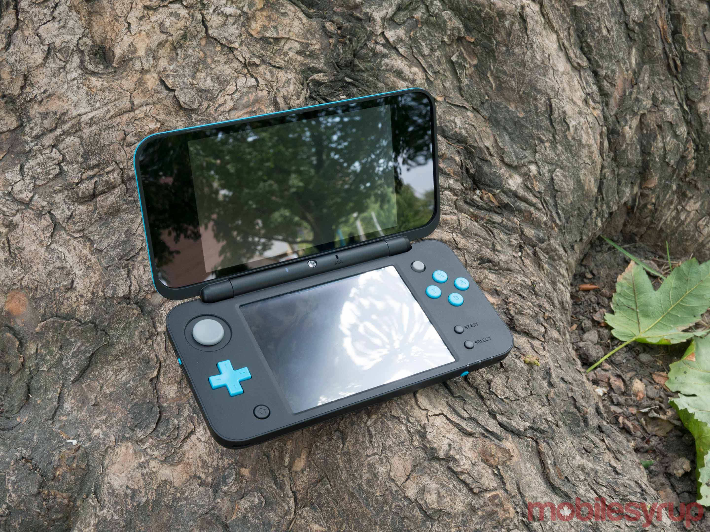 Nintendo 2DS XL on tree