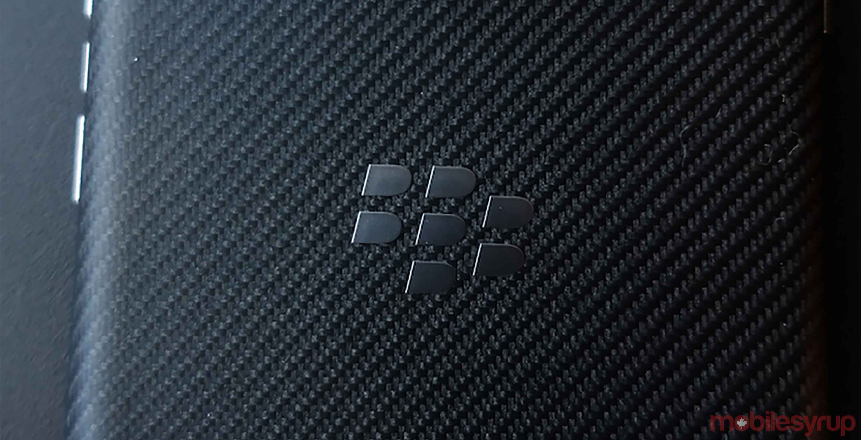 An image of the BlackBerry logo on the back of a BlackBerry phone