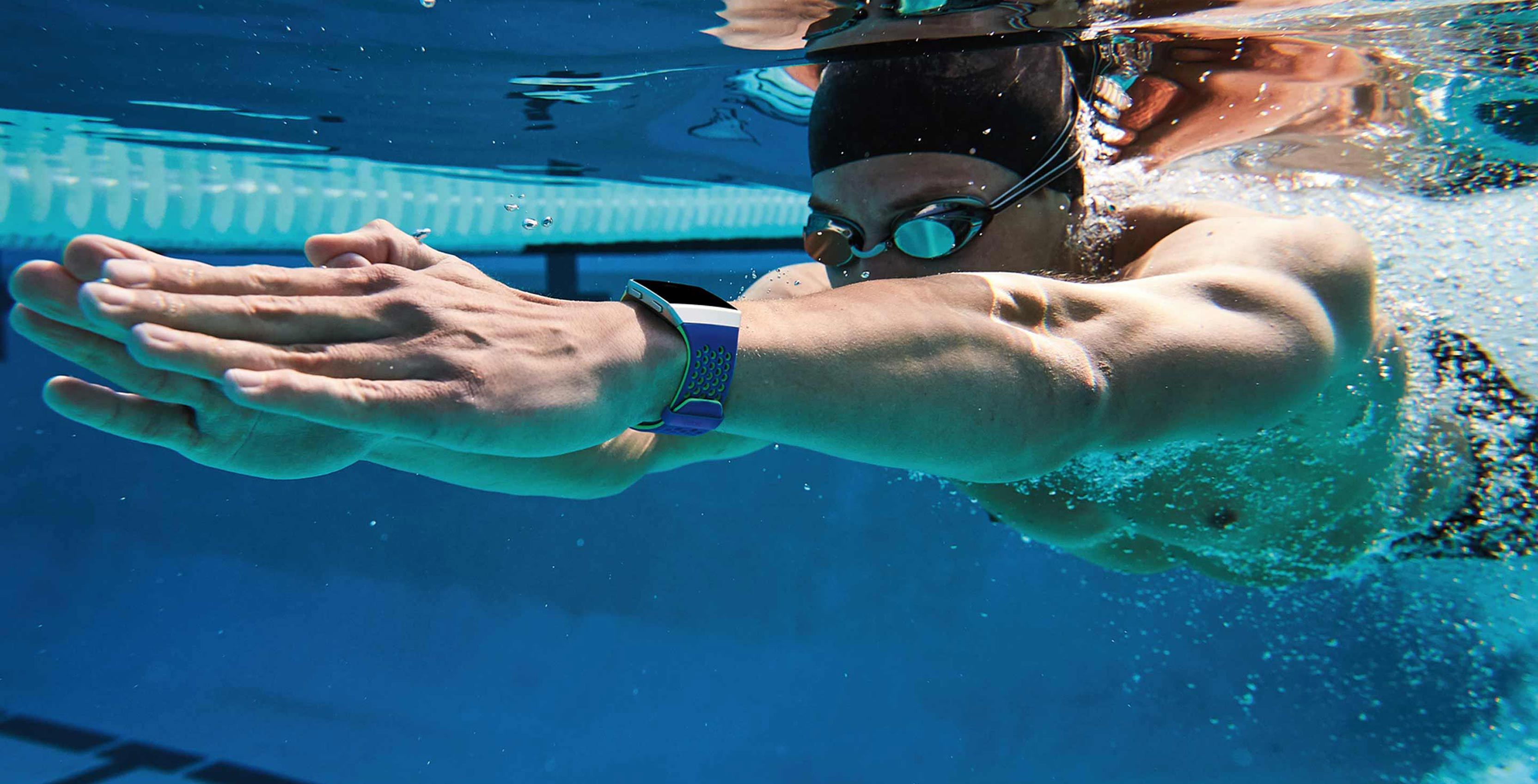 Swimmer using Fitbit Ionic smartwatch