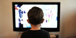 Child in front of screen