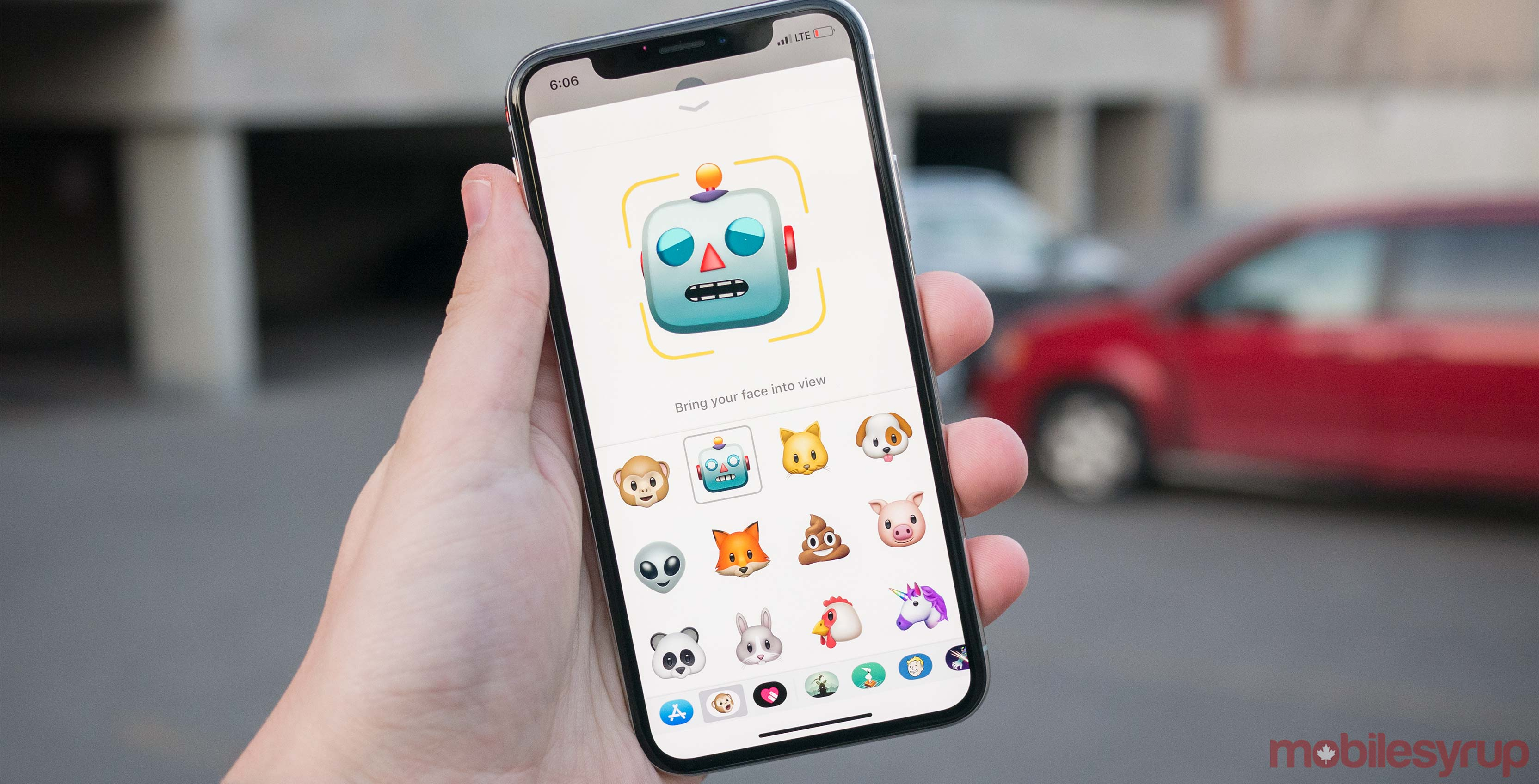 iPhone X animoji in hand