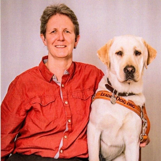 Megan McHugh and her guide dog Kajun