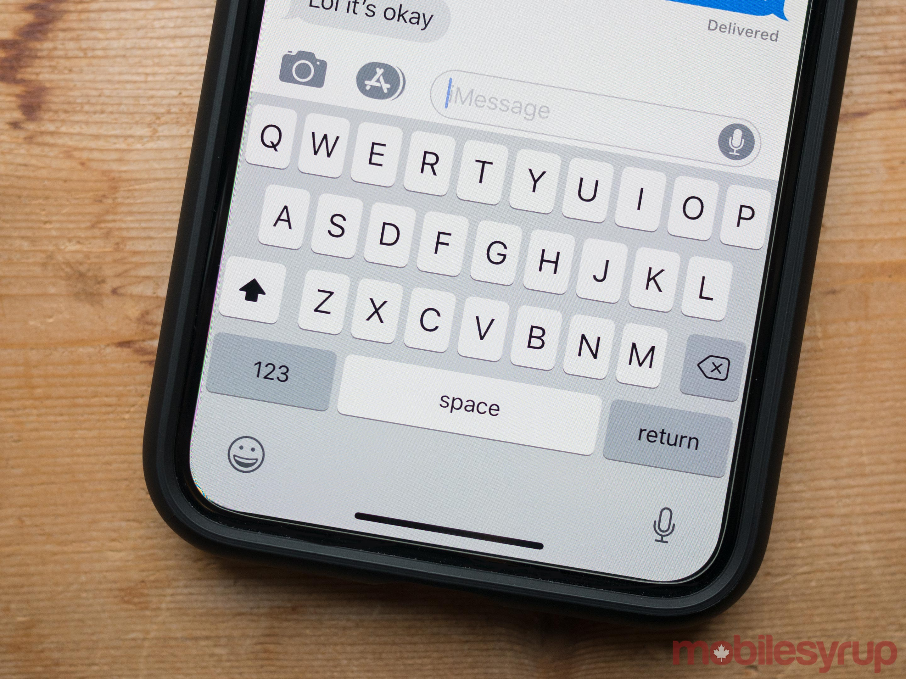 The iOS keyboard on an iPhone X -- a device without a physical home button