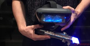 Jedi Challenges headset and lightsaber in hand
