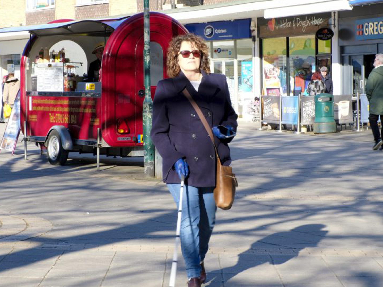 A woman using Microsofts Soundscape app