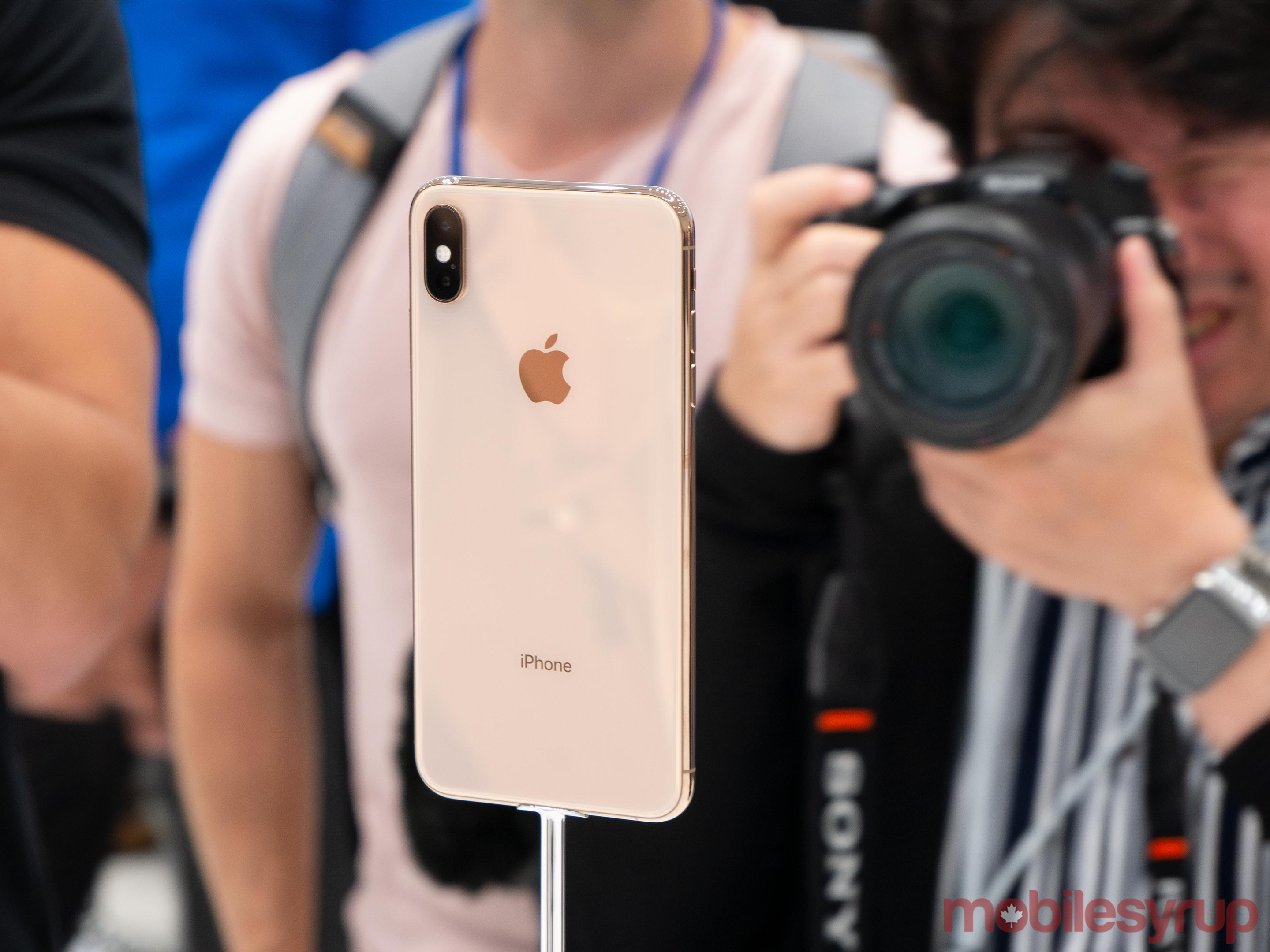 iPhone XS in stand