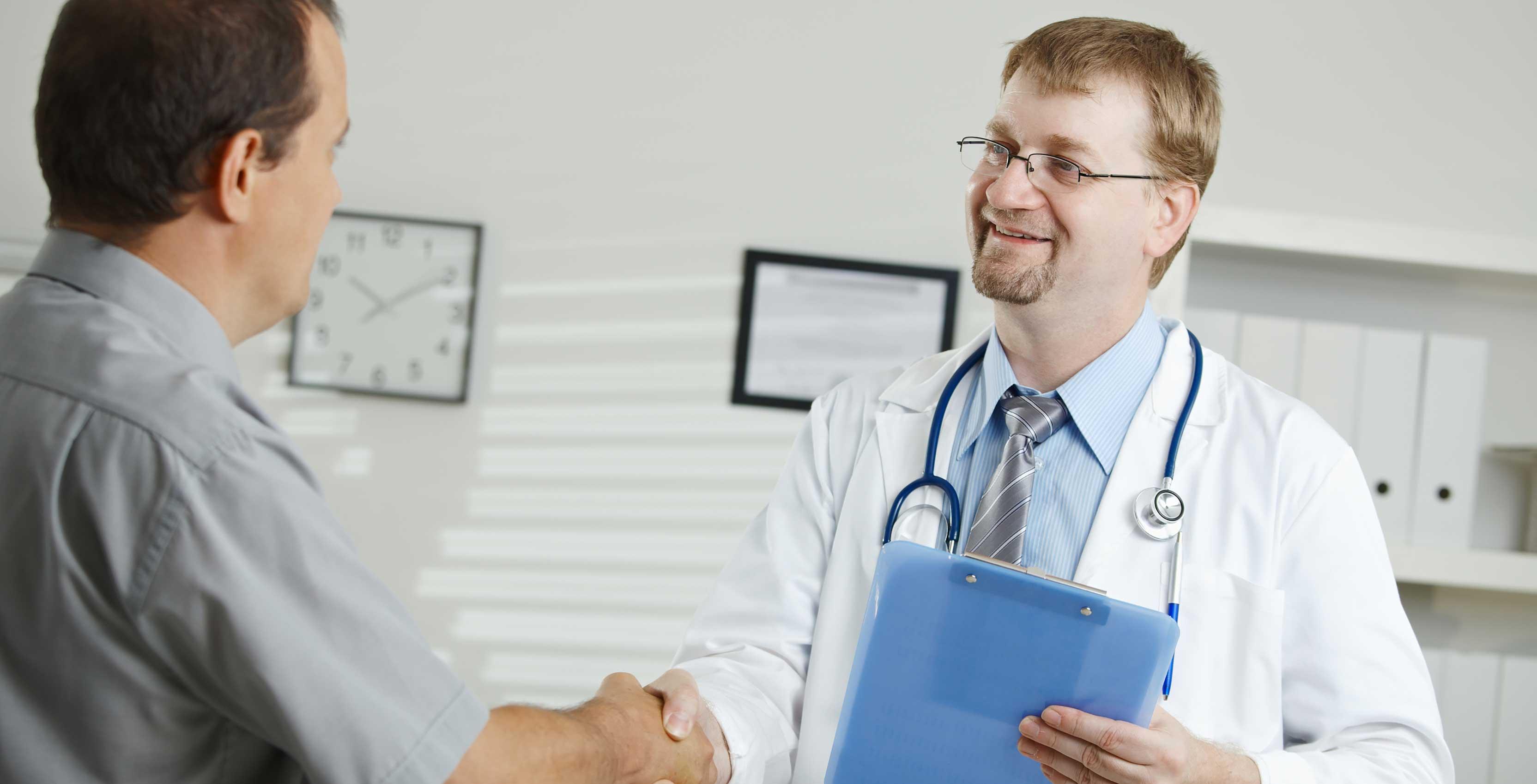 Doctor shaking patient's hand