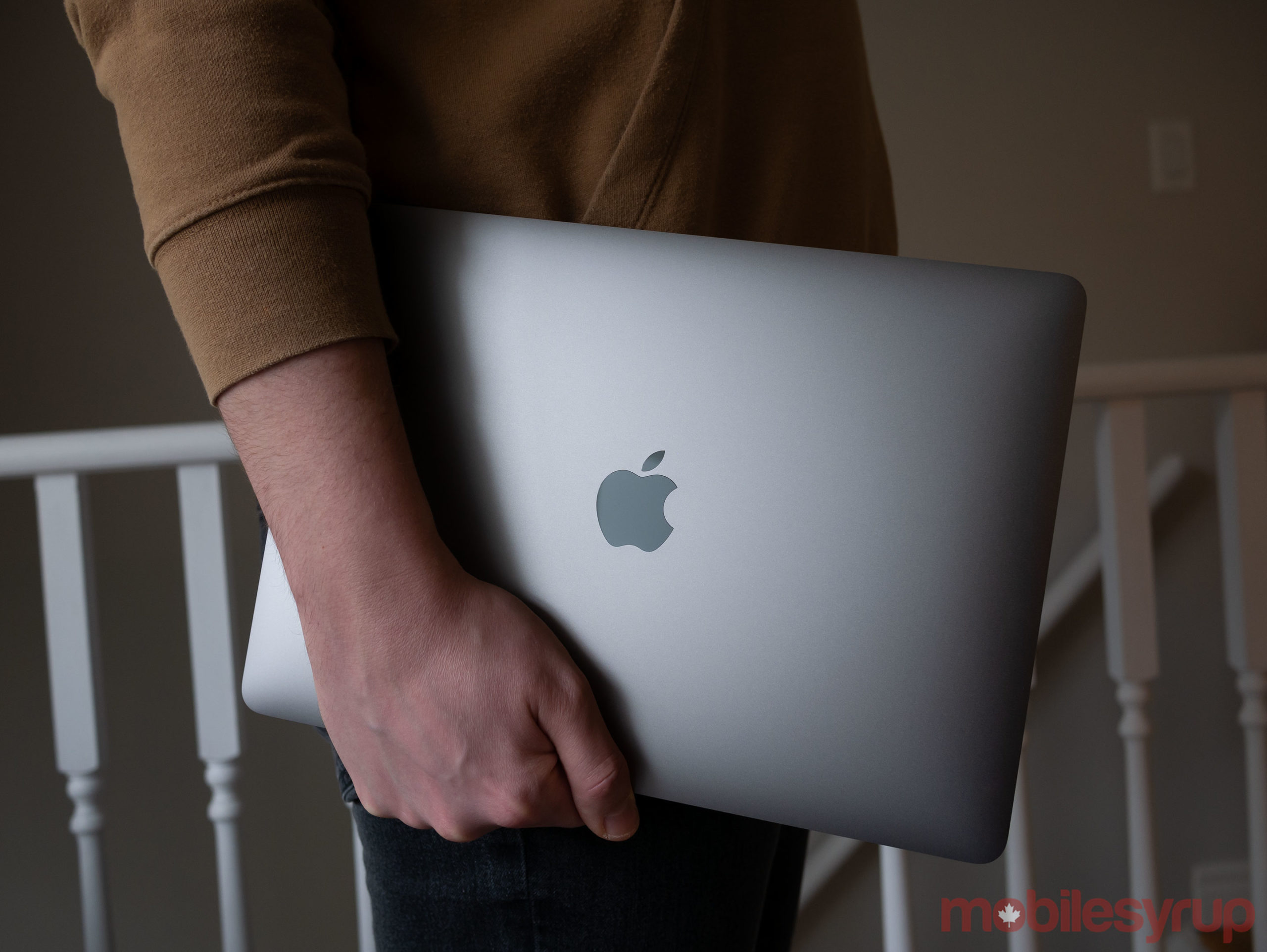 2020 MacBook Air in hand and closed