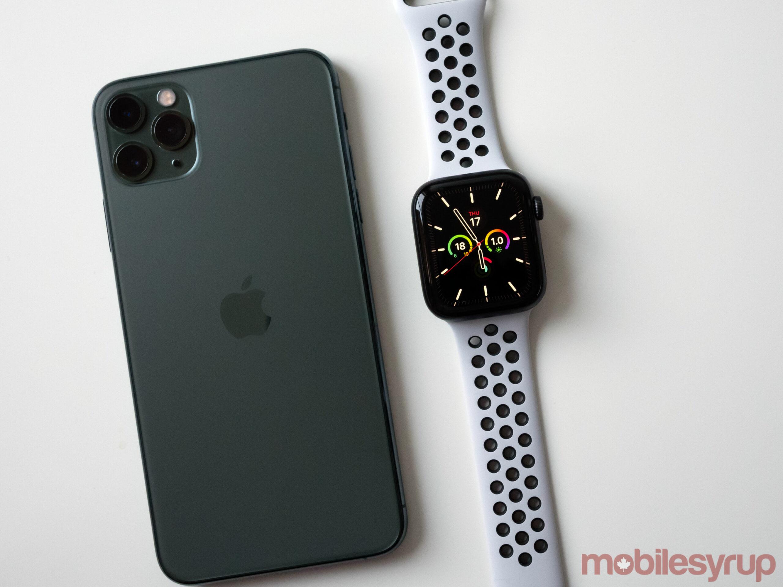 Apple Watch SE beside iPhone 11 Pro Max