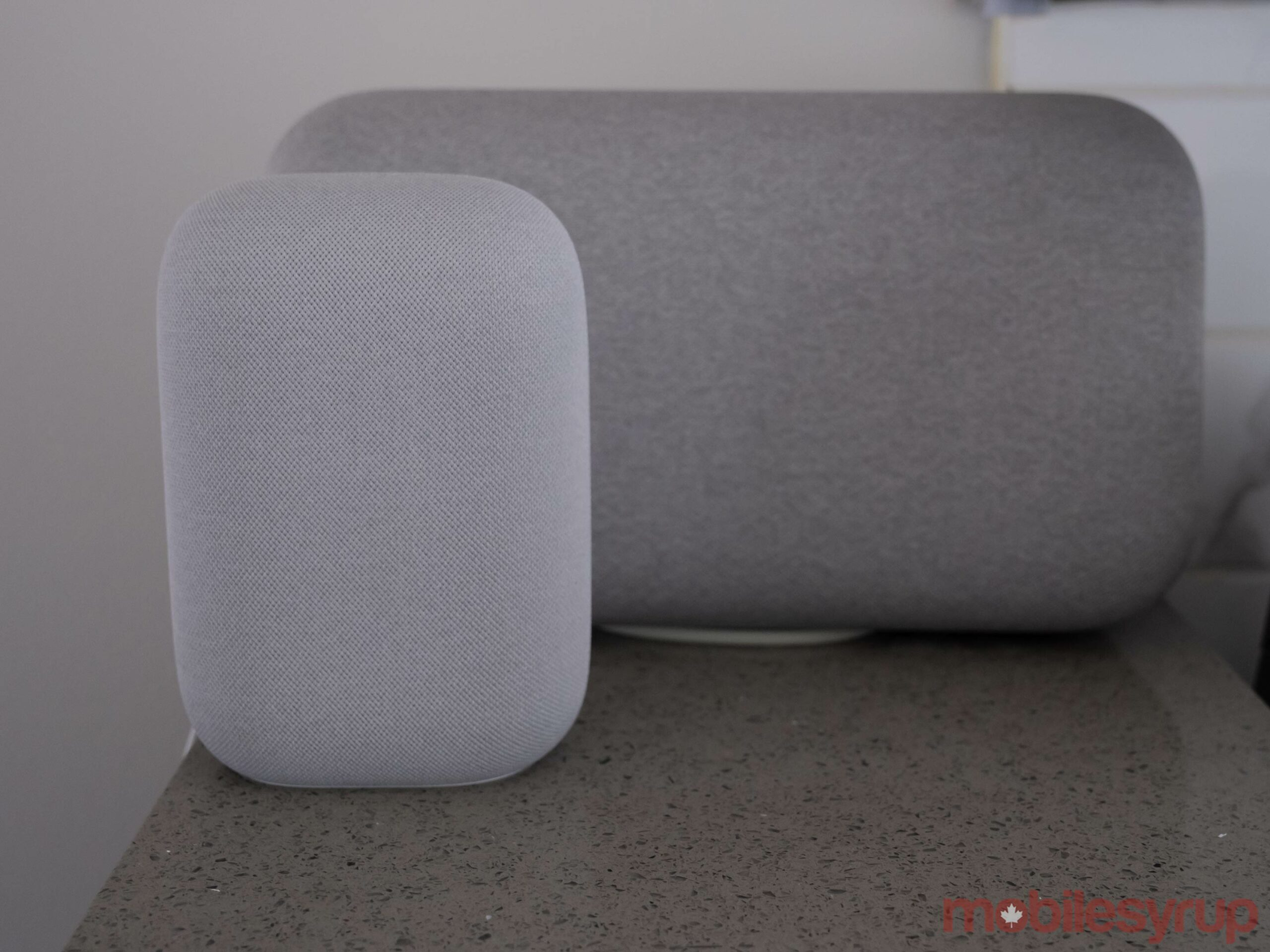 Nest Audio beside Google Home Max