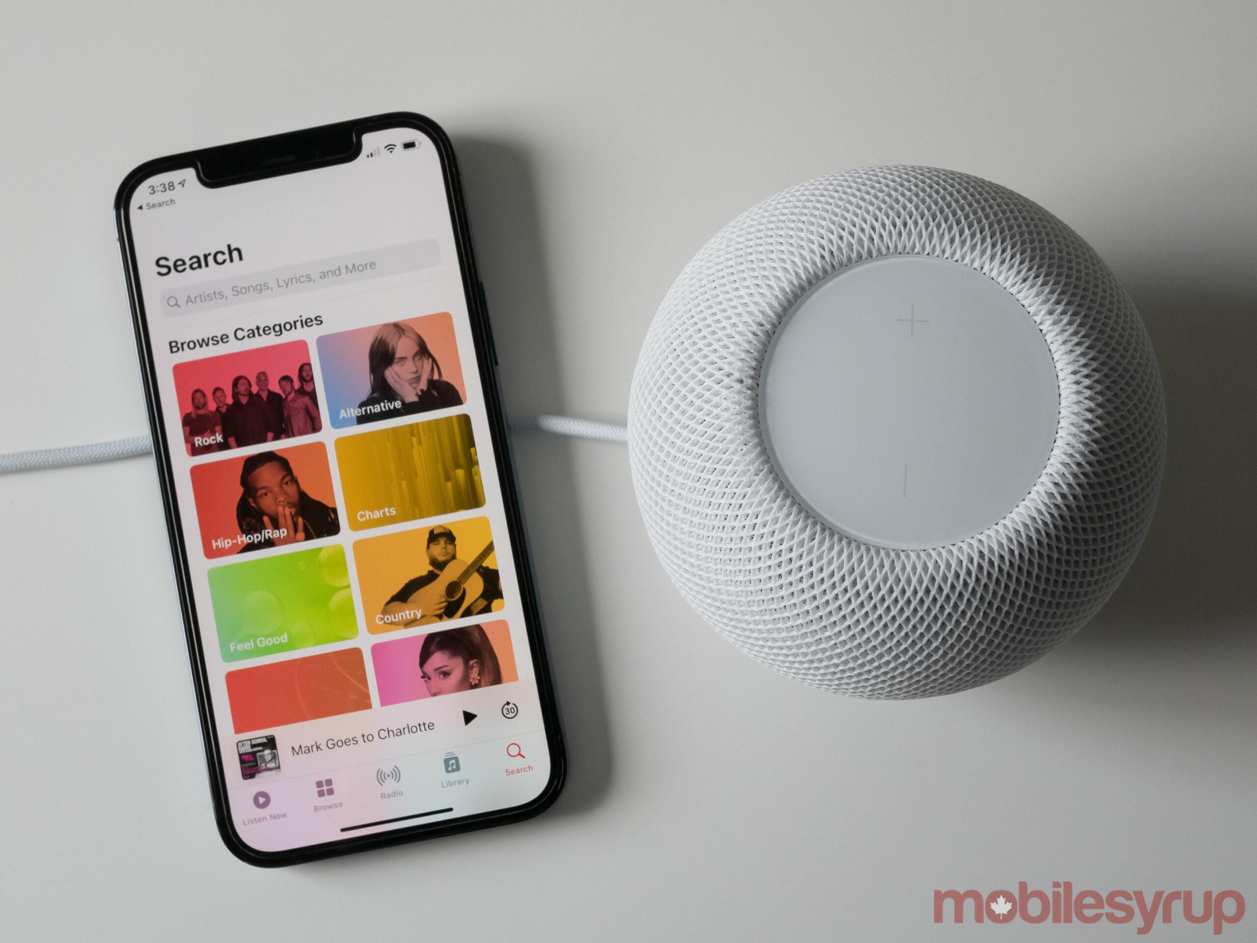 HomePod mini beside the iPhone