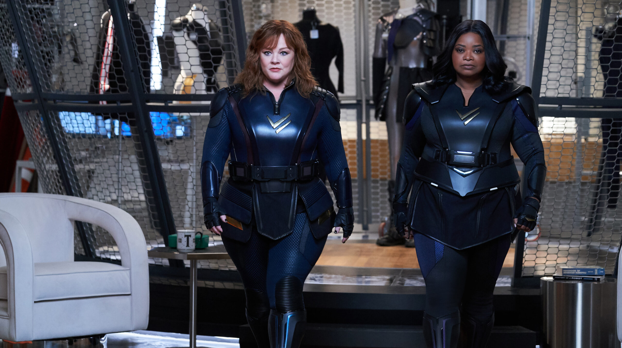 Melissa McCarthy and Octavia Spencer walking beside each other in skin tight black Thunder Force outfit