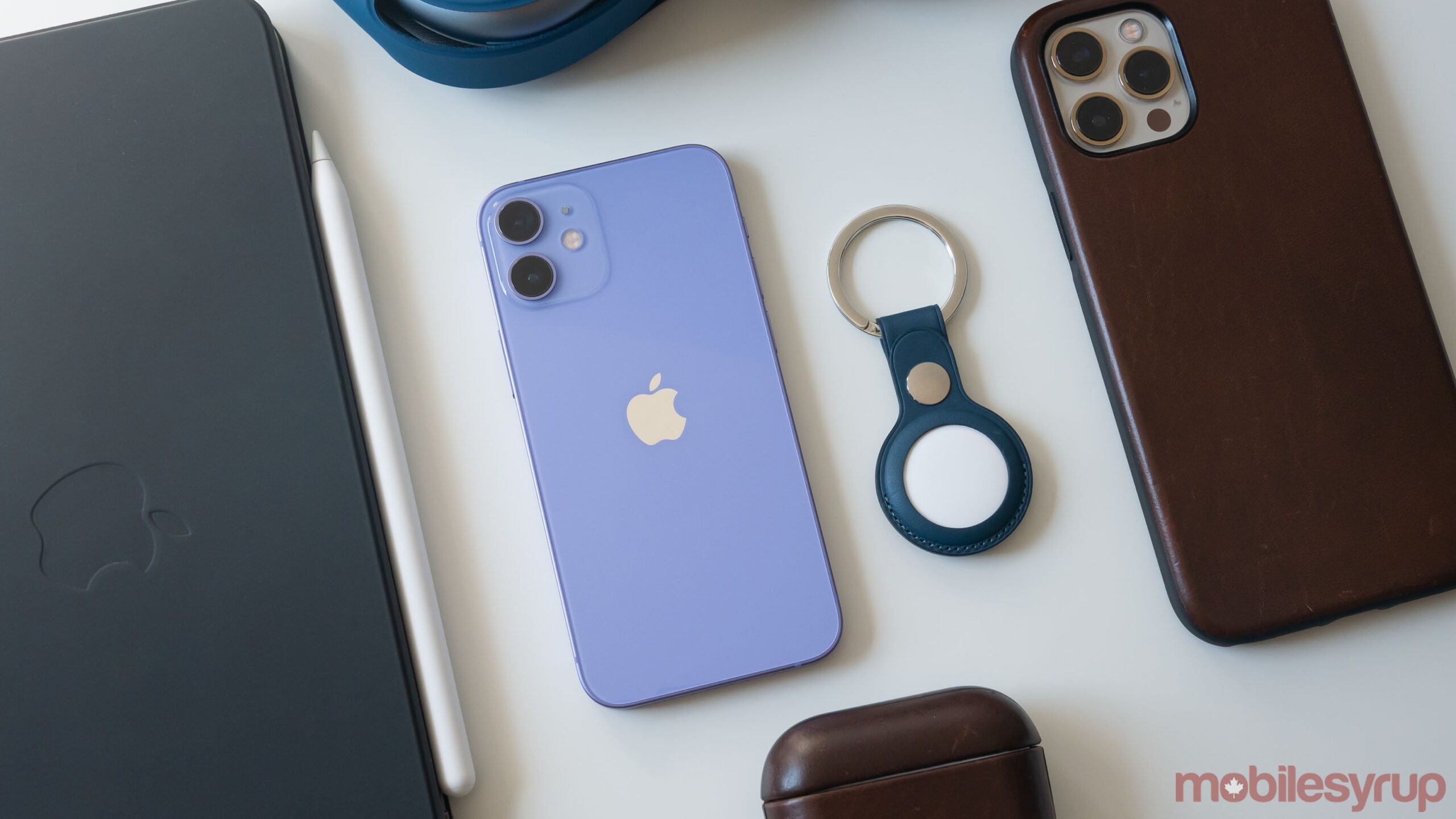 Purple iPhone 12 and AirTag
