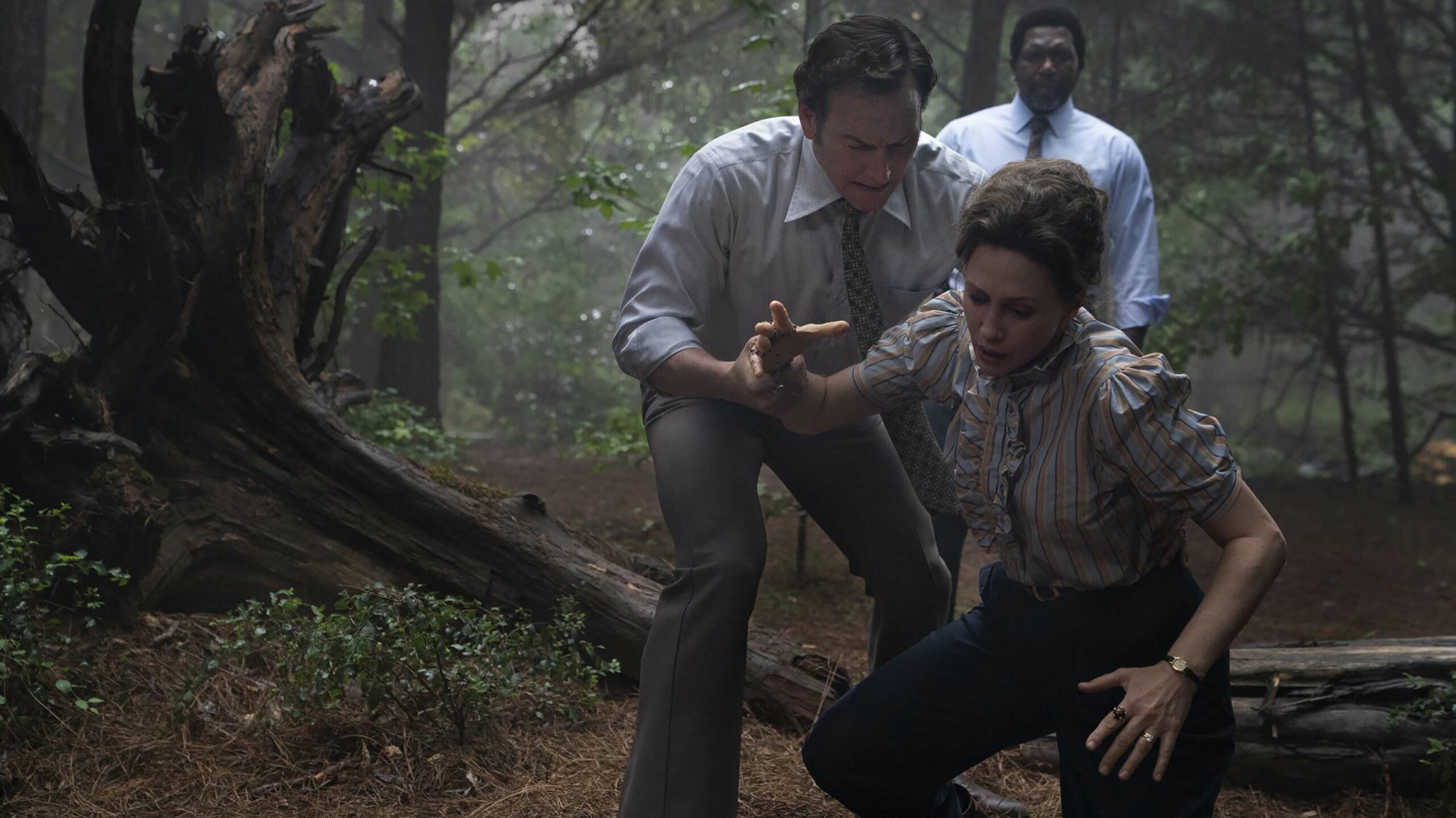 The Conjuring: The Devil Made Me Do It Ed and Lorraine Wilson in forest