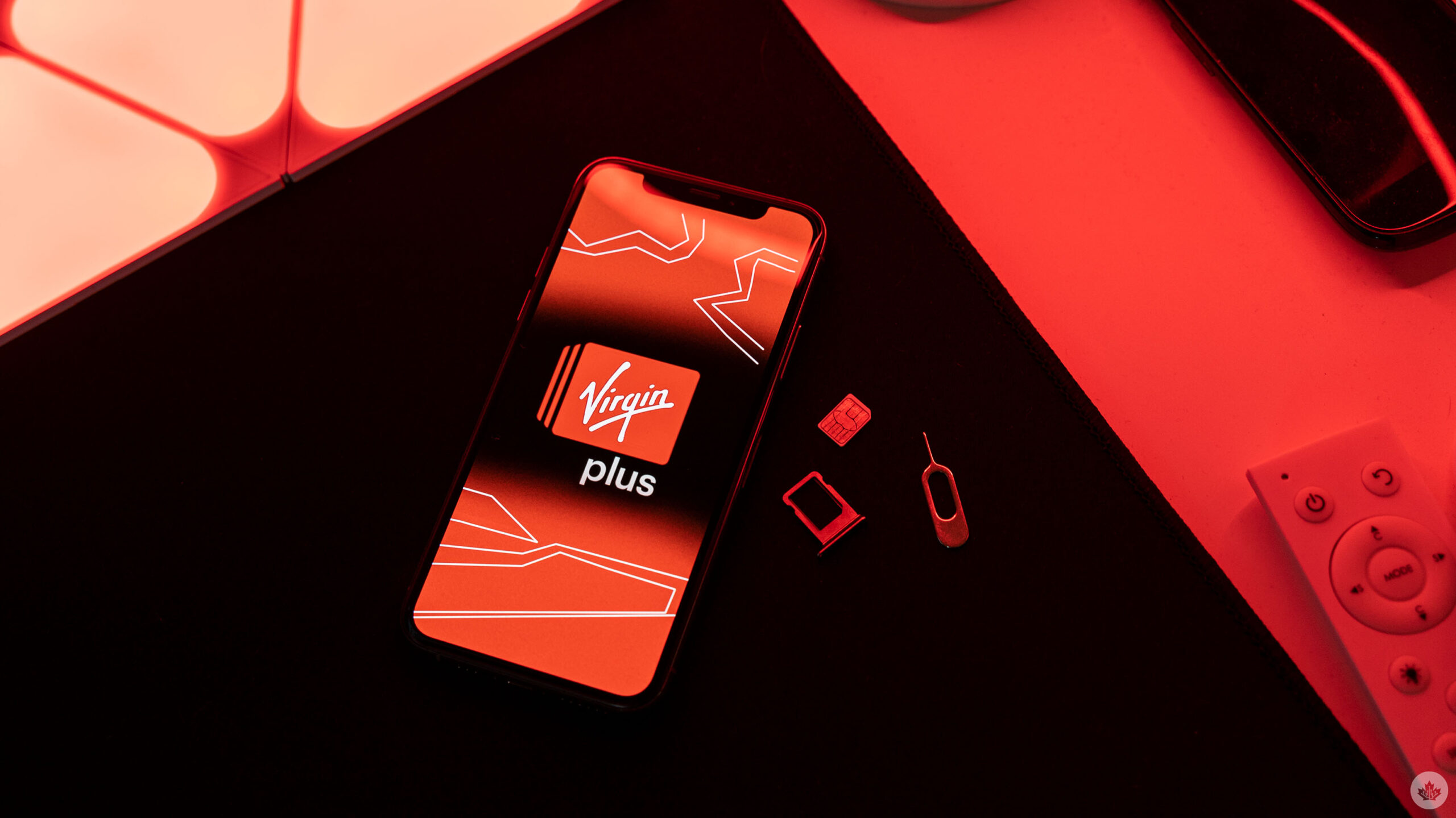 Virgin Plus logo on a phone with SIM card